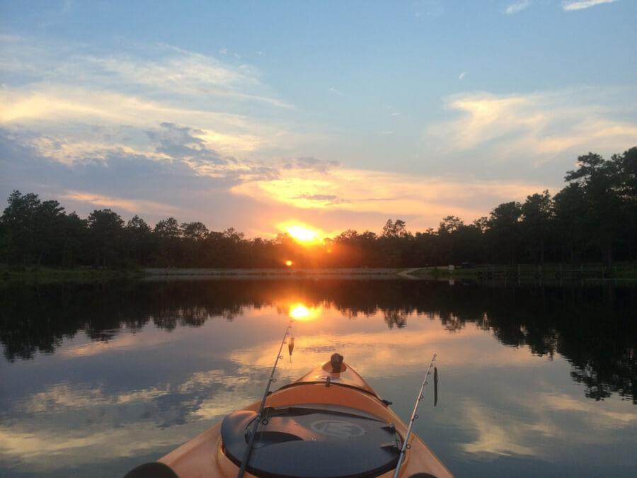 angler fishing from kayak on lake