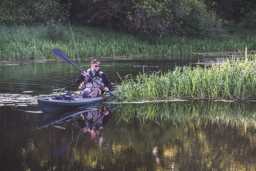 angler fishing from the kayak in the river
