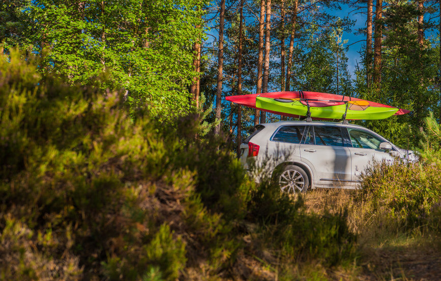 car with two fishing kayaks on the roof rack
