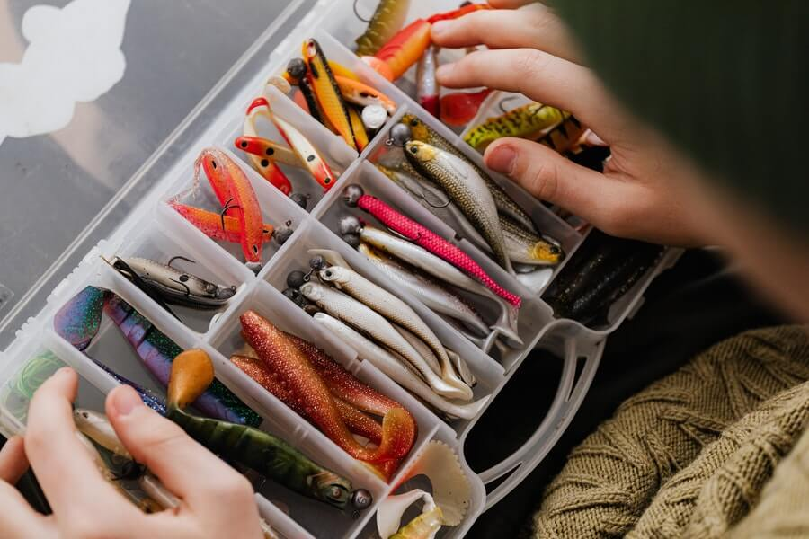 different types of fishing lures in tackle box