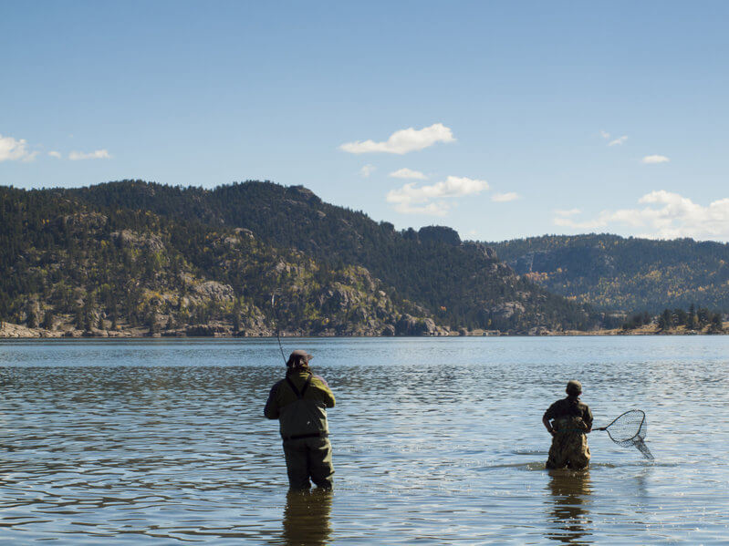 father and son fly fishing together on early morning