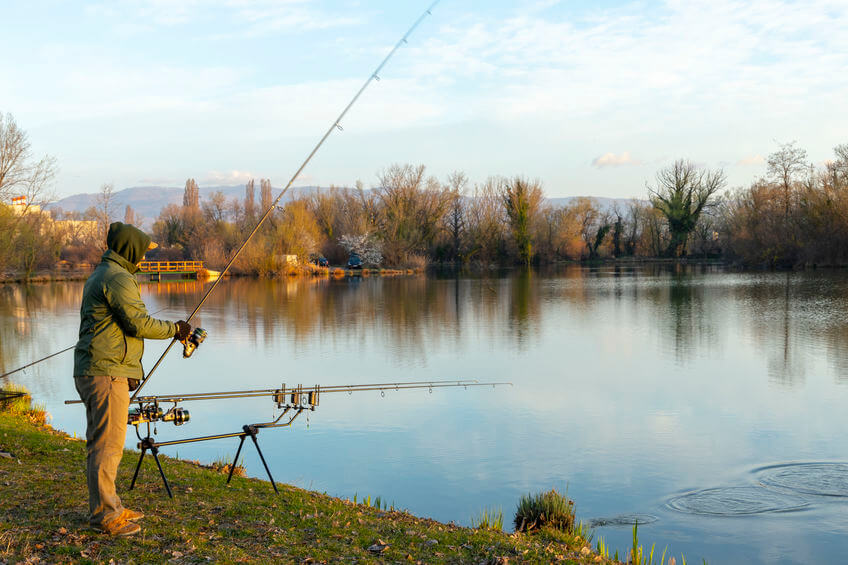 fisherman carp fishing on a sunny morning