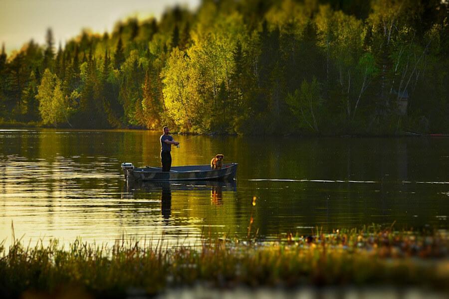 fisherman fishing from boat in lake