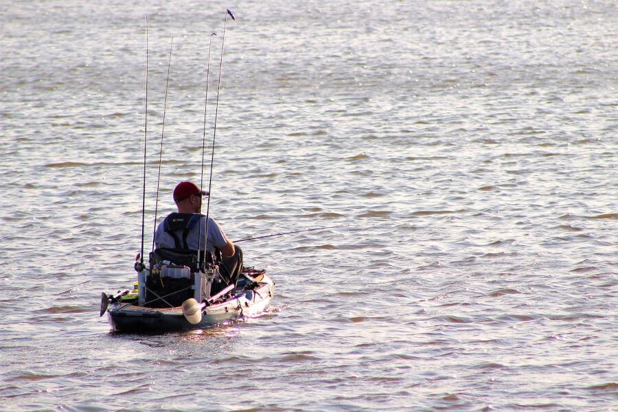 fisherman fishing from kayak