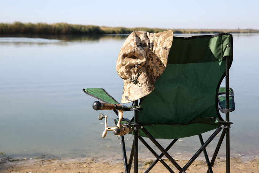fishing chair with fishing rod at riverside