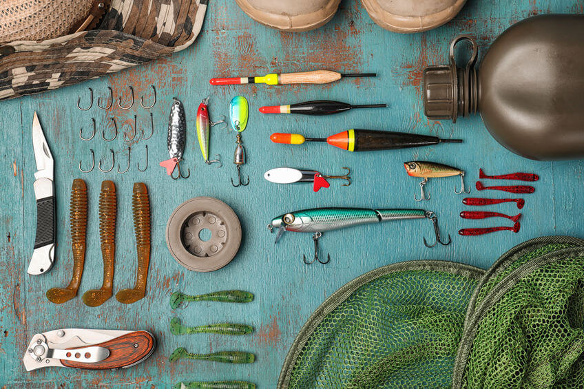fishing equipment on wooden background