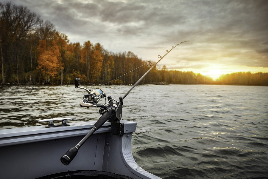fishing from boat in lake with spinning reel