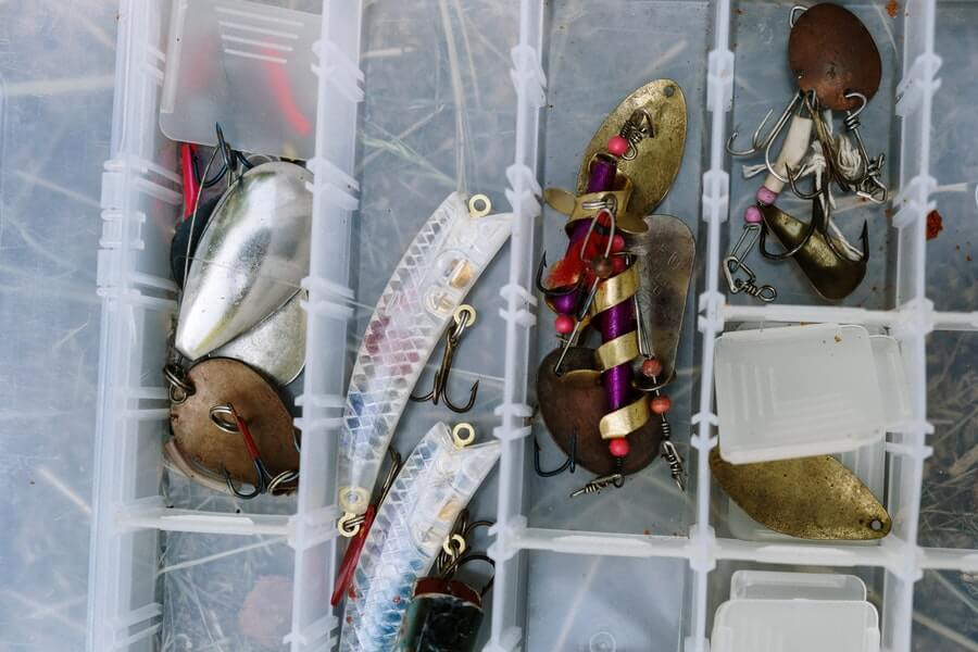 fishing lures in white plastic tackle container
