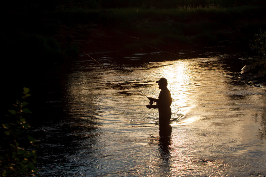 fly fisherman on the river at the night
