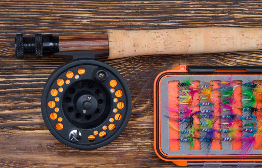 fly fishing rod with a reel and orange fly line