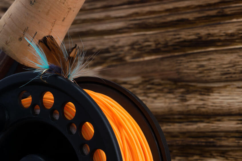 fly reel with orange fishing line