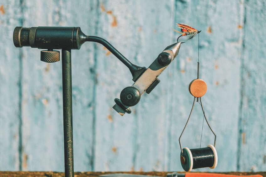 fly tying vise and bobbins for fly fishing