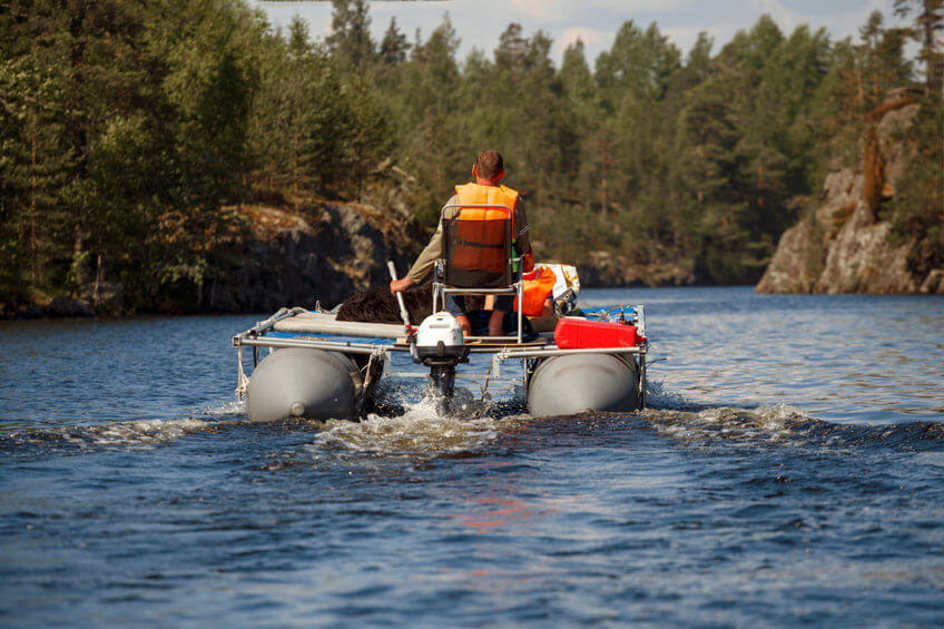 inflatable motor pontoon boat floating on the forest lake