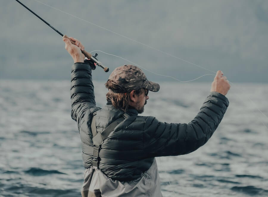 man fly fishing in saltwater