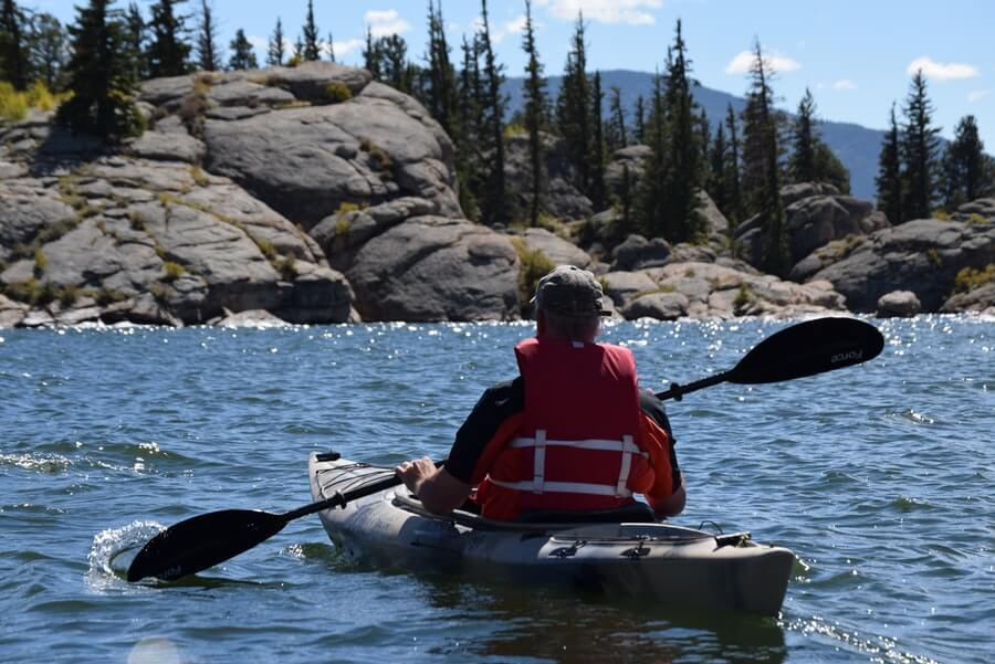 person in kayak at the lake