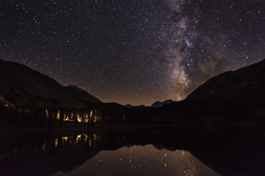 starry night over the mountains and lake