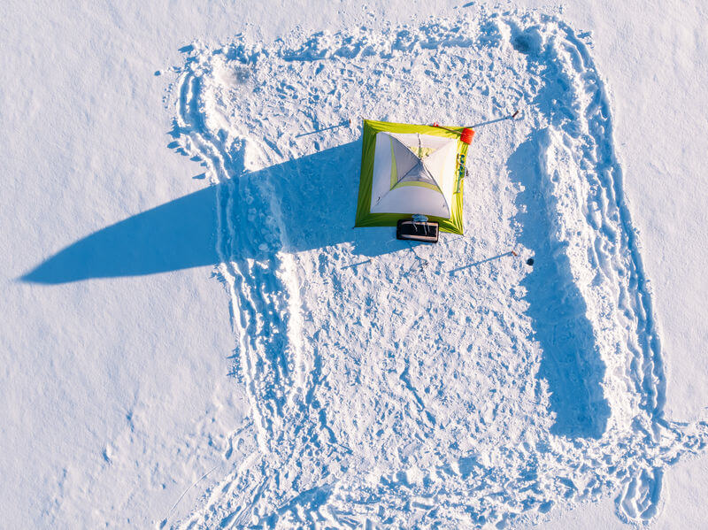 top aerial view of winter ice fishing tent