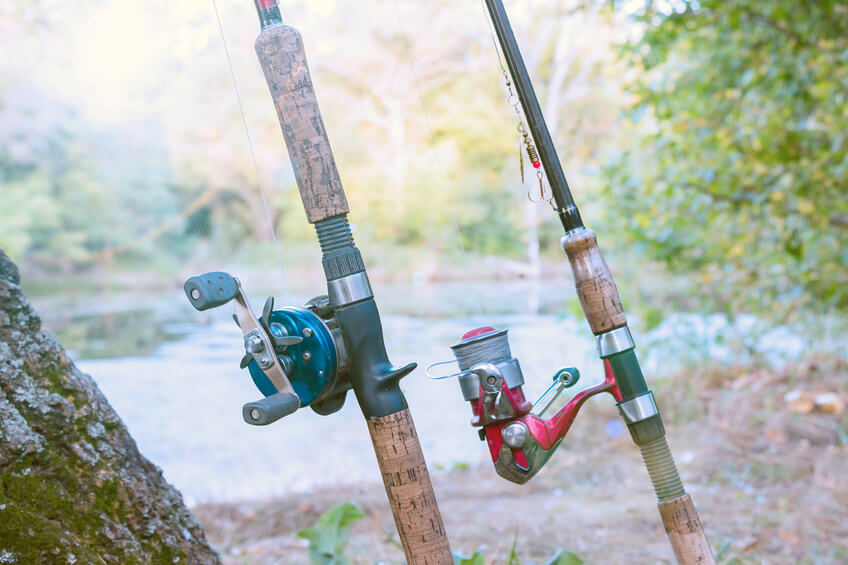 two fishing rods with reels - spinning reel and baitcasting reel