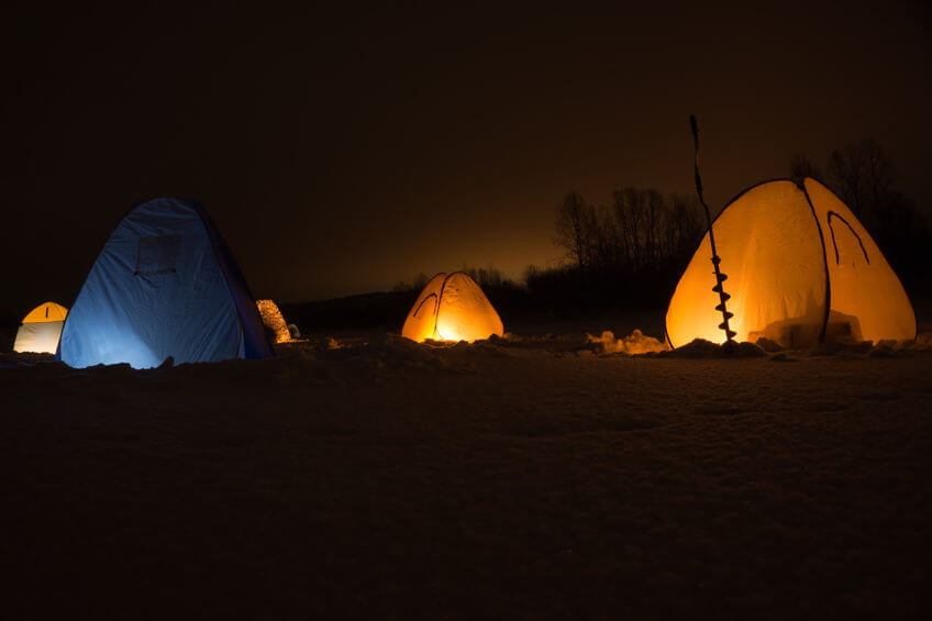 winter ice fishing in the tent at night