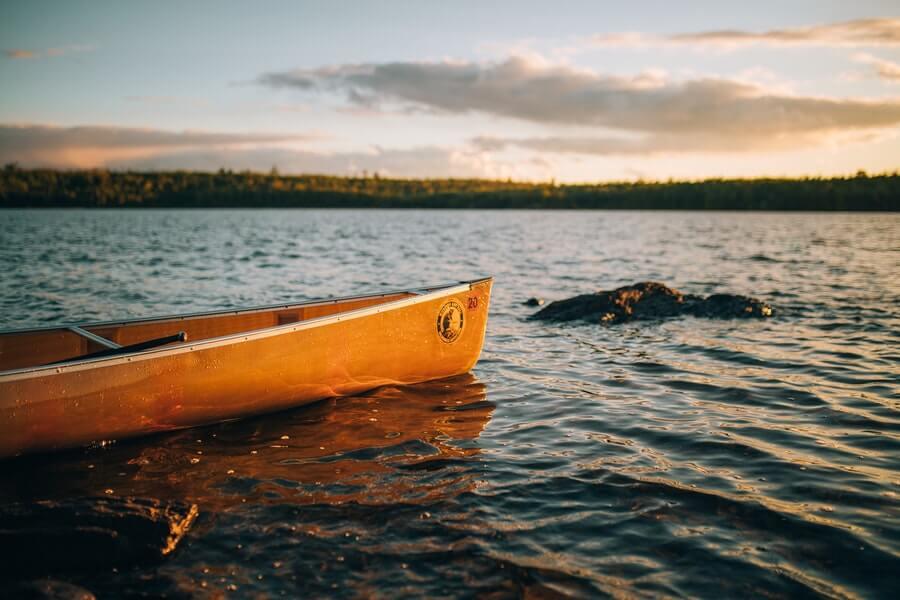 yellow canoe on water